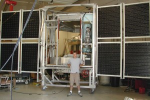 Student in front of BEAST solar panels